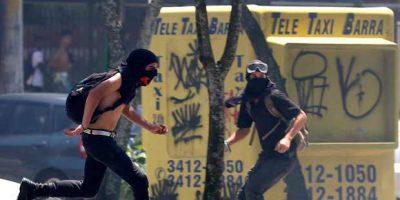 manifestantes-mascarados-Rio-de-Janeiro-leilão-Sergio-Moraes-Reuters