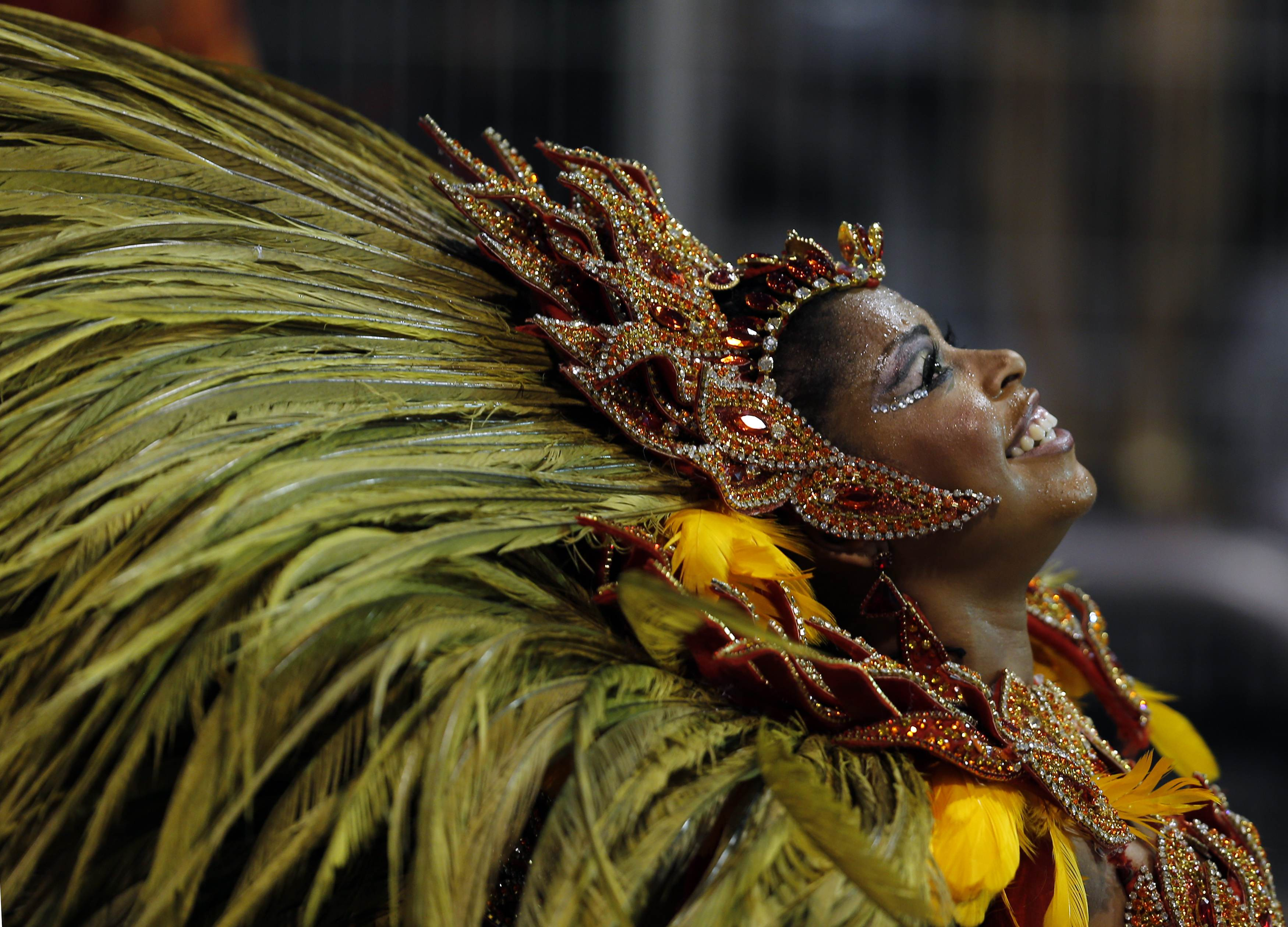 A reveller from the Vai Vai samba school takes part in the first night of the Special Group category of the annual Carnival parade in Sao Paulo