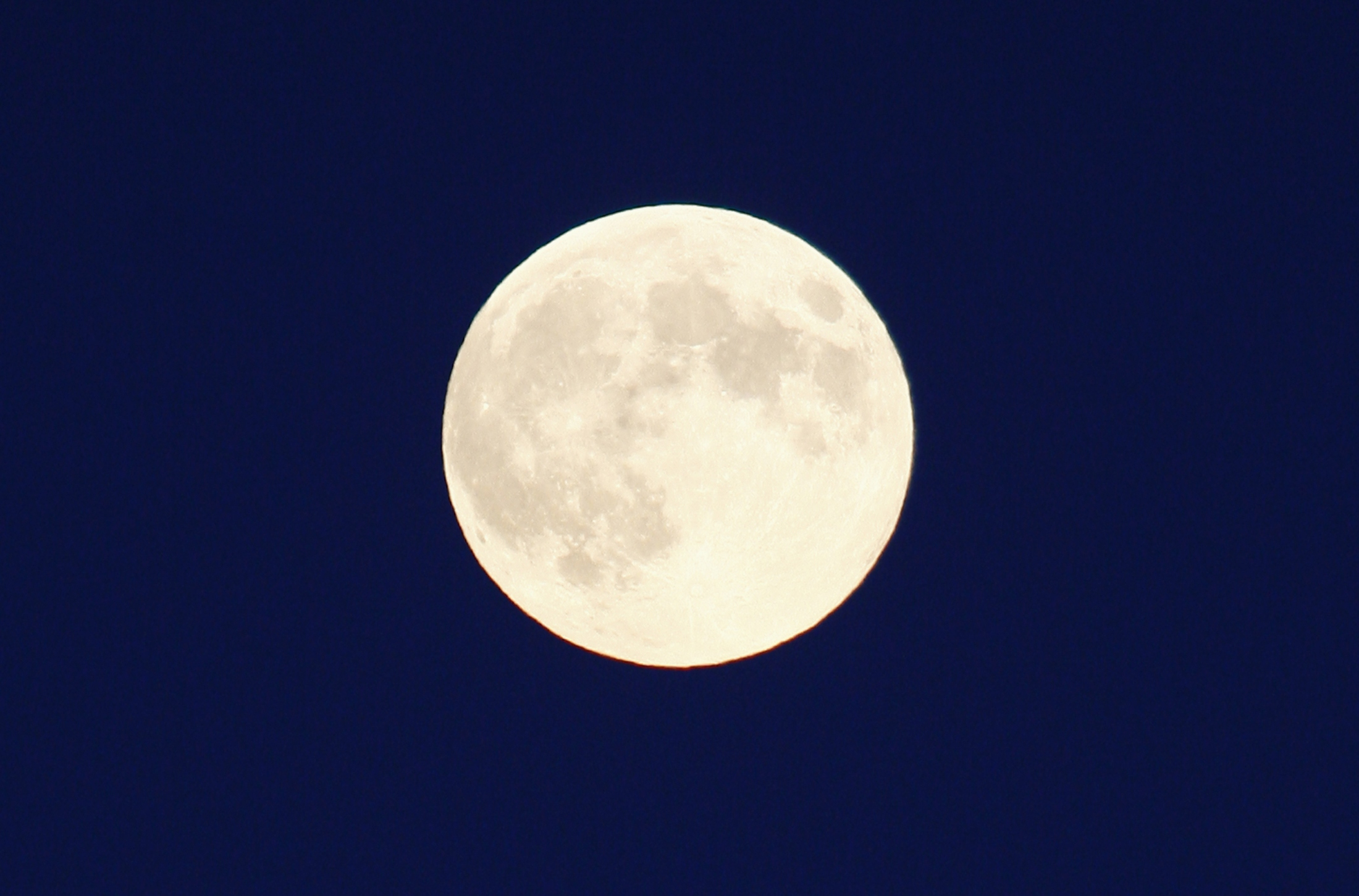A full moon, also a harvest moon, rises over Halton Hills, Ontario outside Toronto