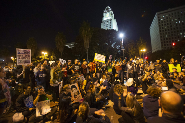 Protesters gather outside LAPD headquarters in Los Angeles, California