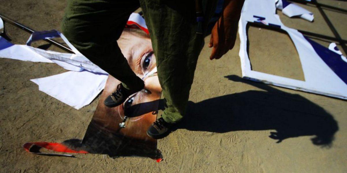 [FOTOS] Ecologistas adherentes de Rendón retiran letreros de Bachelet en Providencia