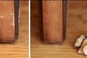 Si frotas una nuez en los muebles dañados, cubrirá los deterioros.. Imagen Por: