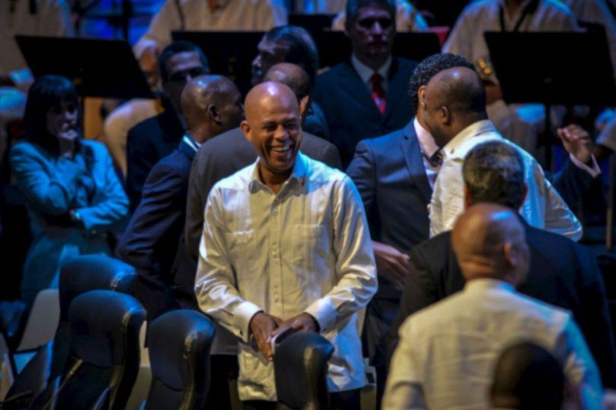 El presidente haitiano, Michel Martelly, sonríe durante la ceremonia de apertura. Foto:AFP. Imagen Por: