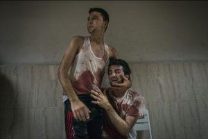 """Tercer lugar, categoría """"Historia en Noticias Generales"""": La imagen captada por Sergey Ponomarev de Rusia muestra a dos hermanos en el conflicto en la Franja de Gaza Foto:World Press Photo 2015. Imagen Por:"""