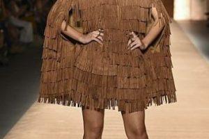 No todo son vestidos fastuosos para Paulina Vega. Foto:vía AFP. Imagen Por: