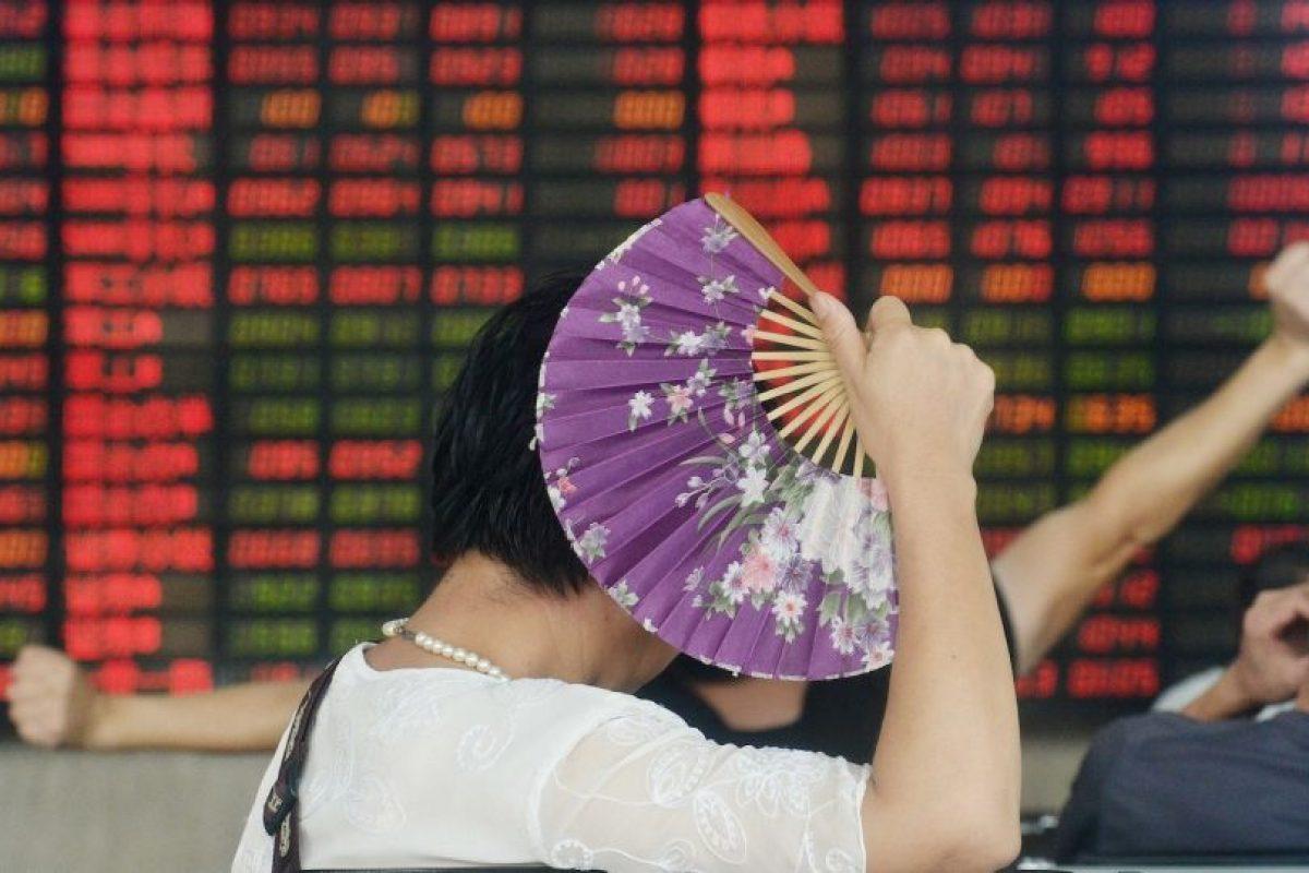 Inversor de china con un abanico. Foto:AFP. Imagen Por: