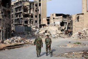 Soldados caminan en Aleppo, Siria. Foto:AFP. Imagen Por: