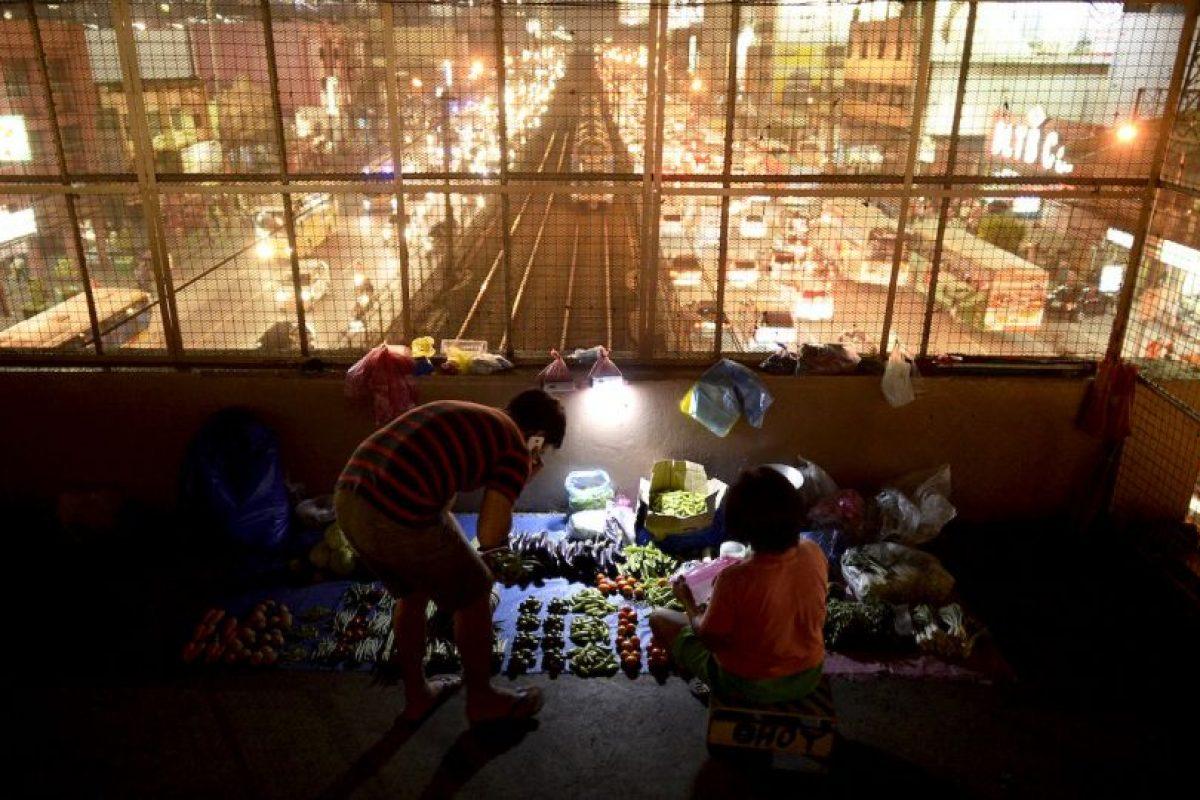Vendedor de vegetales en Manila, Filipinas. Foto:AFP. Imagen Por: