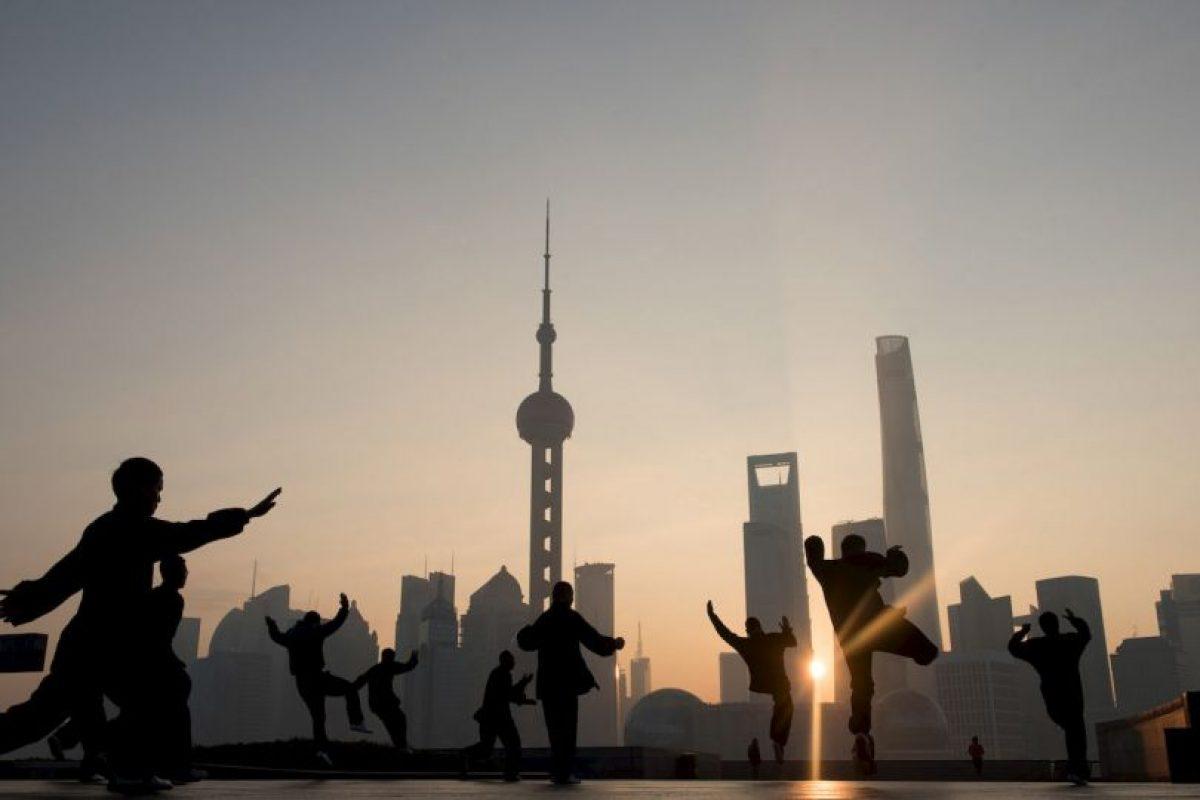 Personas ejercitándose en China. Foto:AFP. Imagen Por: