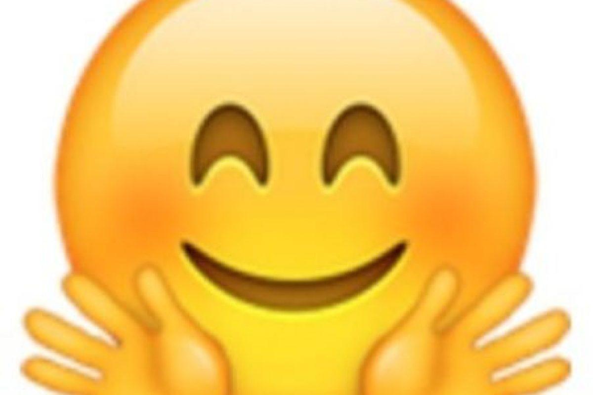 Rostro sonrojado con dos manos. Foto:vía emojipedia.org. Imagen Por: