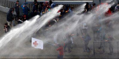 Fotos: así se vive el conflicto entre Carabineros y estudiantes en marcha por la Alameda