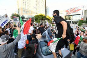Algunos portaban la bandera mexicana Foto:AFP. Imagen Por: