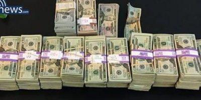 Taxista regresó 187 mil dólares en efectivo olvidados en su auto