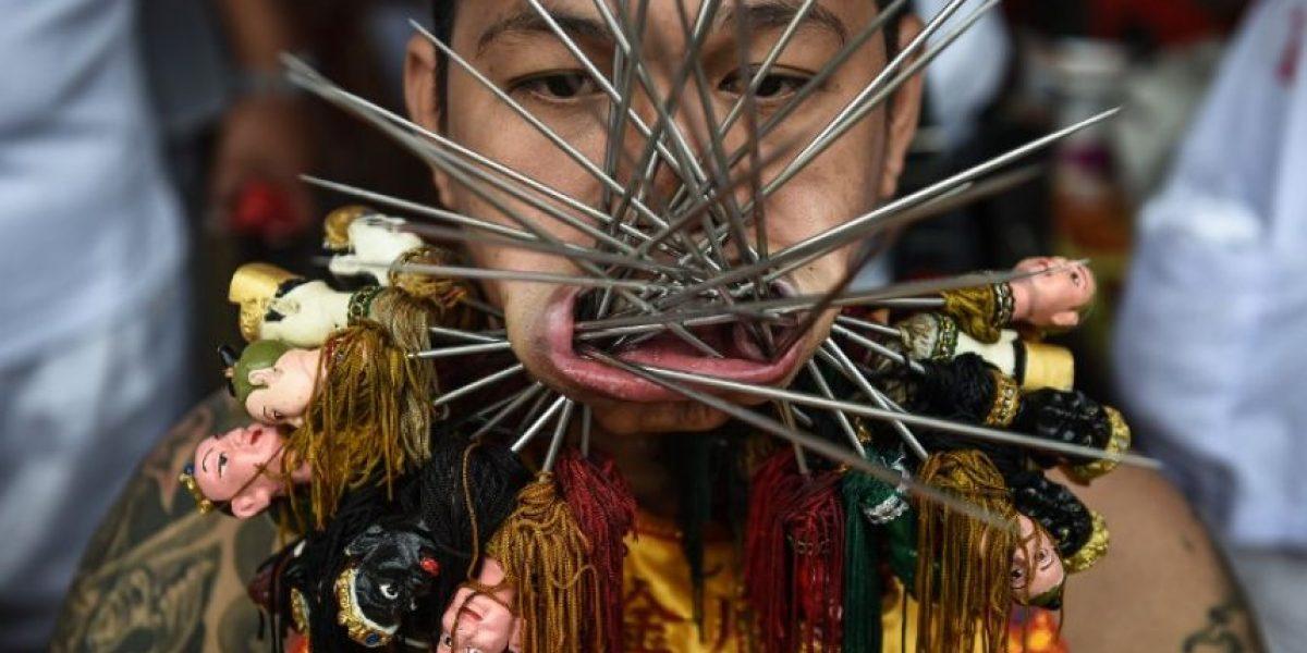 Las prácticas extremas del festival vegetariano de los Nueve Emperadores Dioses en Tailandia