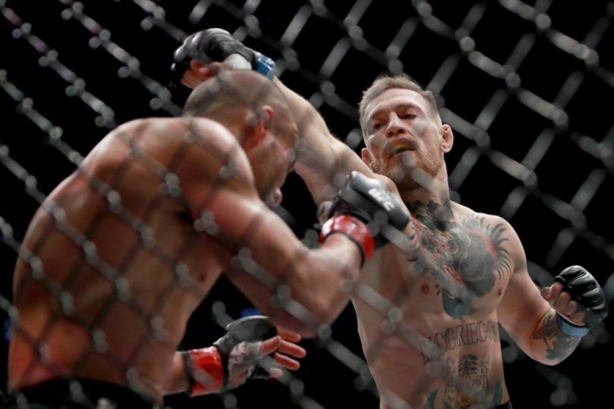 Con esto, se convierte en el primer hombre en tener dos títulos en simultáneo en la UFC Foto:Getty Images. Imagen Por: