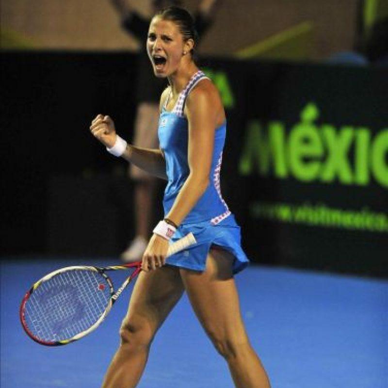 La tenista de Luxemburgo Mandy Miella celebra su victoria ante Yaroslava Shevedova de Kazajistán este jueves 23 de febrero de 2012, en el cuarto día del Abierto Femenino de Monterrey en México. EFE