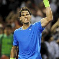 El tenista español Rafael Nadal celebra tras vencer ante el francés Jo-Wilfried Tsonga en un partido del torneo de tenis de Miami disputado este miércoles 28 de marzo de 2012, en Cayo Vizcaíno, Florida (EE.UU.). EFE