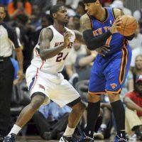 El alero Carmelo Anthony de los New York Knicks (d) controla la pelota ante Marvin Williams de los Atlanta Hawks durante el primer cuarto del partido de la NBA, disputado en el Philips Arena de Atlanta, Georgia, este 22 de abril. EFE