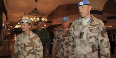 Miembros de la misión de la ONU a su llegada al hotel Sheraton tras inspeccionar la ciudad de Damasco Siria. EFE