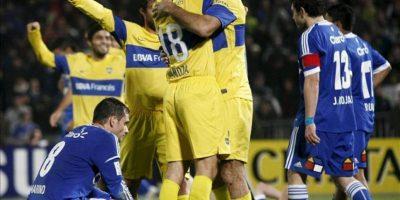 Jugadores de Boca Juniors celebran tras vencer a Universidad de Chile en la serie por la semifinal de la Copa Libertadores este 21 de junio en el Estadio Nacional en Santiago de Chile. EFE