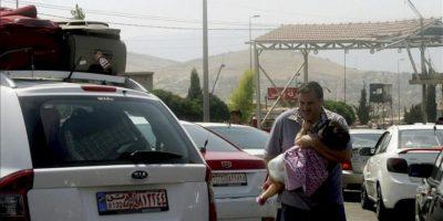 Familias sirias cruzan a Libia desde el punto de Al Masnaa, Líbano. La actual situación en Siria está forzando a muchos ciudadanos a salir del país. EFE/Archivo