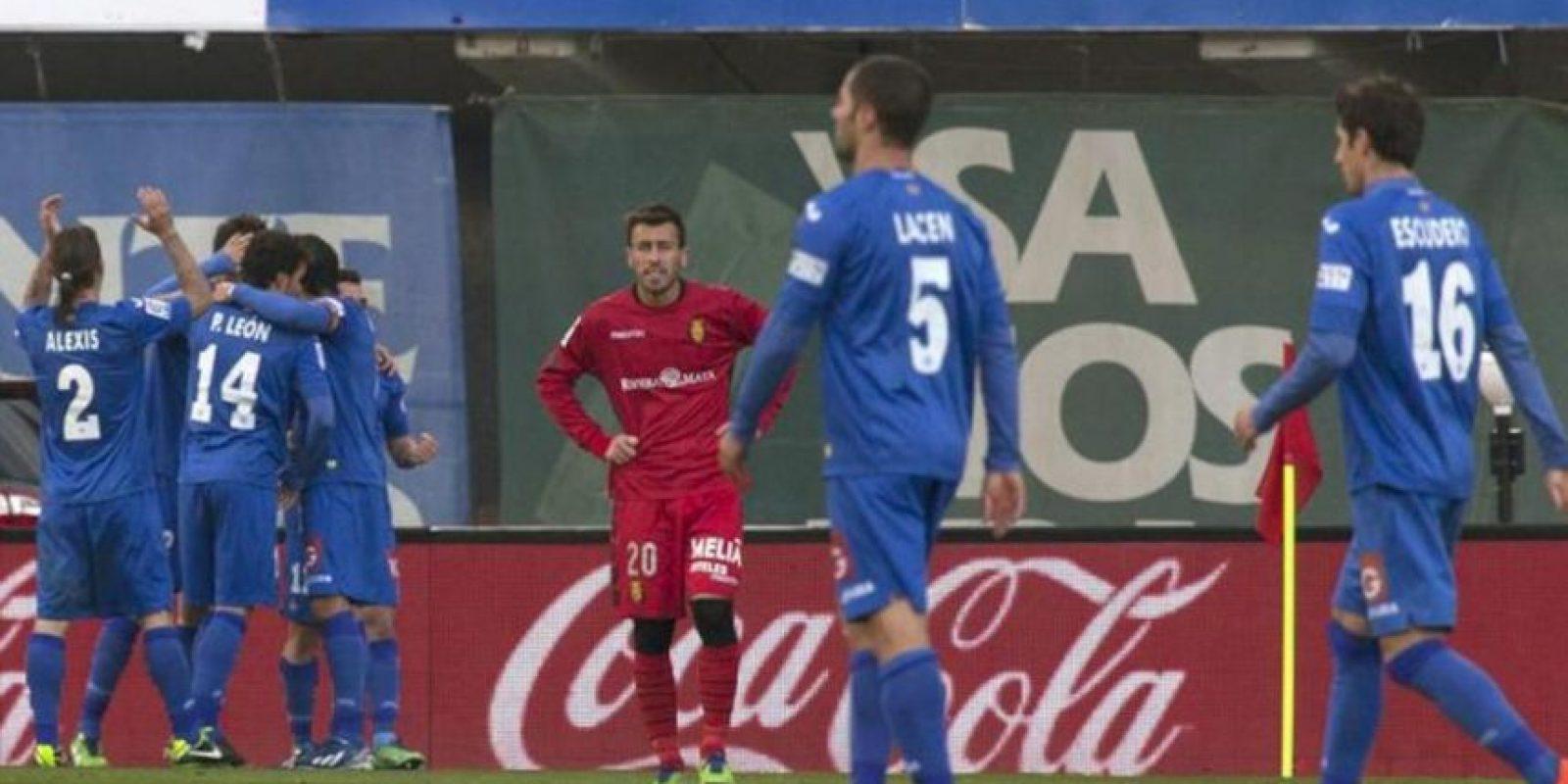 Los jugadores del Getafe celebran uno de los goles marcados al RCD Mallorca, durante el partido de la vigésimo quinta jornada de Liga de Primera División, disputado en el estadio Iberostar de Palma de Mallorca. EFE