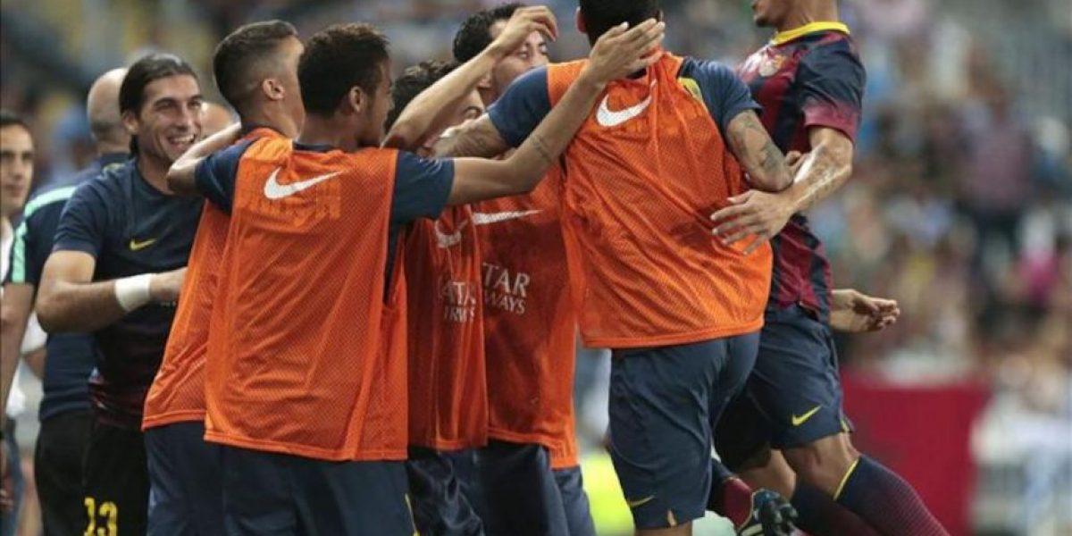 El Barça, sin Messi, gana con apuros en Málaga y el Atlético se da un festín
