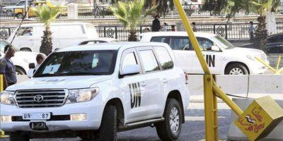 Varios vehículos de la ONU llegan a Damasco (Siria), hoy, lunes 26 de agosto de 2013, tras ser disparados durante su investigación del supuesto ataque químico en la periferia de la ciudad. EFE
