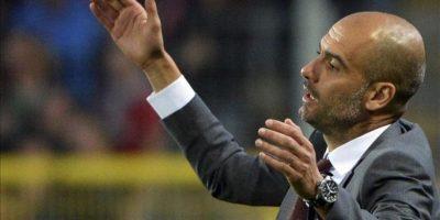 El entrenador del Bayern Múnich, Josep Pep Guardiola, gesticula durante el partido de la Bundesliga alemana entre el SC Friburgo y el FC Bayern Múnich en el estadio Mage Solar en Friburgo, Alemania. El partido terminó 1-1. EFE