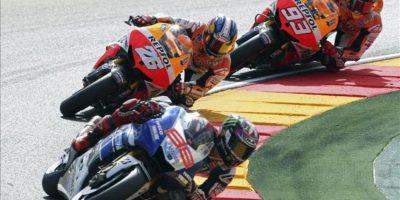 Los pilotos españoles de MotoGP Jorge Lorenzo (Yamaha), Dani Pedrosa y Marc Márquez durante la carrera de Moto GP del Gran Premio de Aragón de motociclismo disputado en el circuito alcañizano de Motorland. EFE