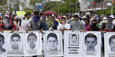 Las autoridades informaron de la existencia de una fosa en Cocula, Guerrero, con restos óseos. Foto:AFP