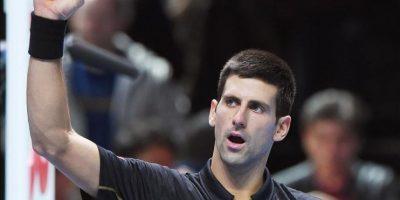 El serbio Novak Djokovic celebra tras vencer el japonés Kei Nishikori, en su partido de semifinal en el ATP World Tour Finals en Londres, Gran Bretaña. EFE