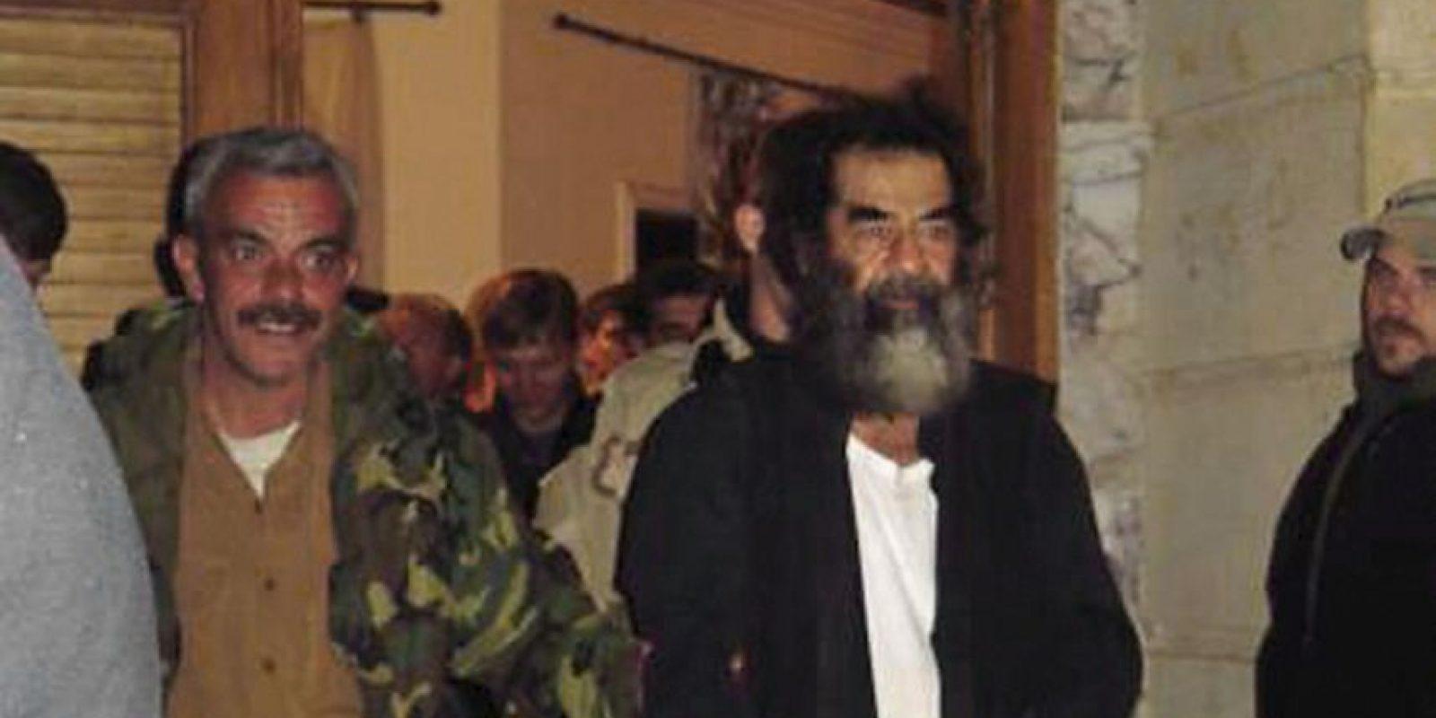 2003: 13 de diciembre, Hussein es capturado Foto:Getty Images