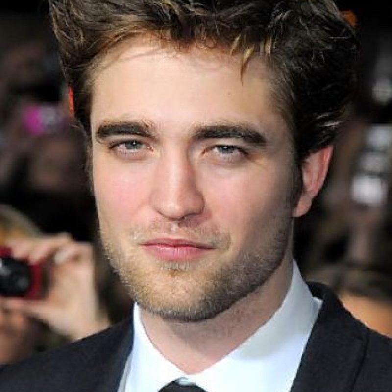 "Robert Pattinson prácticamente le estornudó encima a Reese Whiterspoon en ""Agua para elefantes"". Foto:Getty Images"