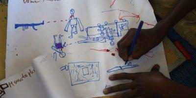 Los dibujos son utilizados como terápia. Foto:AFP