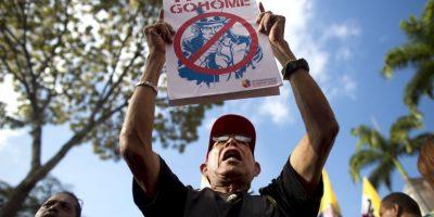 Muchos cubanos rechazan la nueva relación con la Unión Americana. Foto:AP
