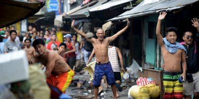 Filipinos protestan por la demolición de una comunidad de bajos recursos económicos. Foto:AFP