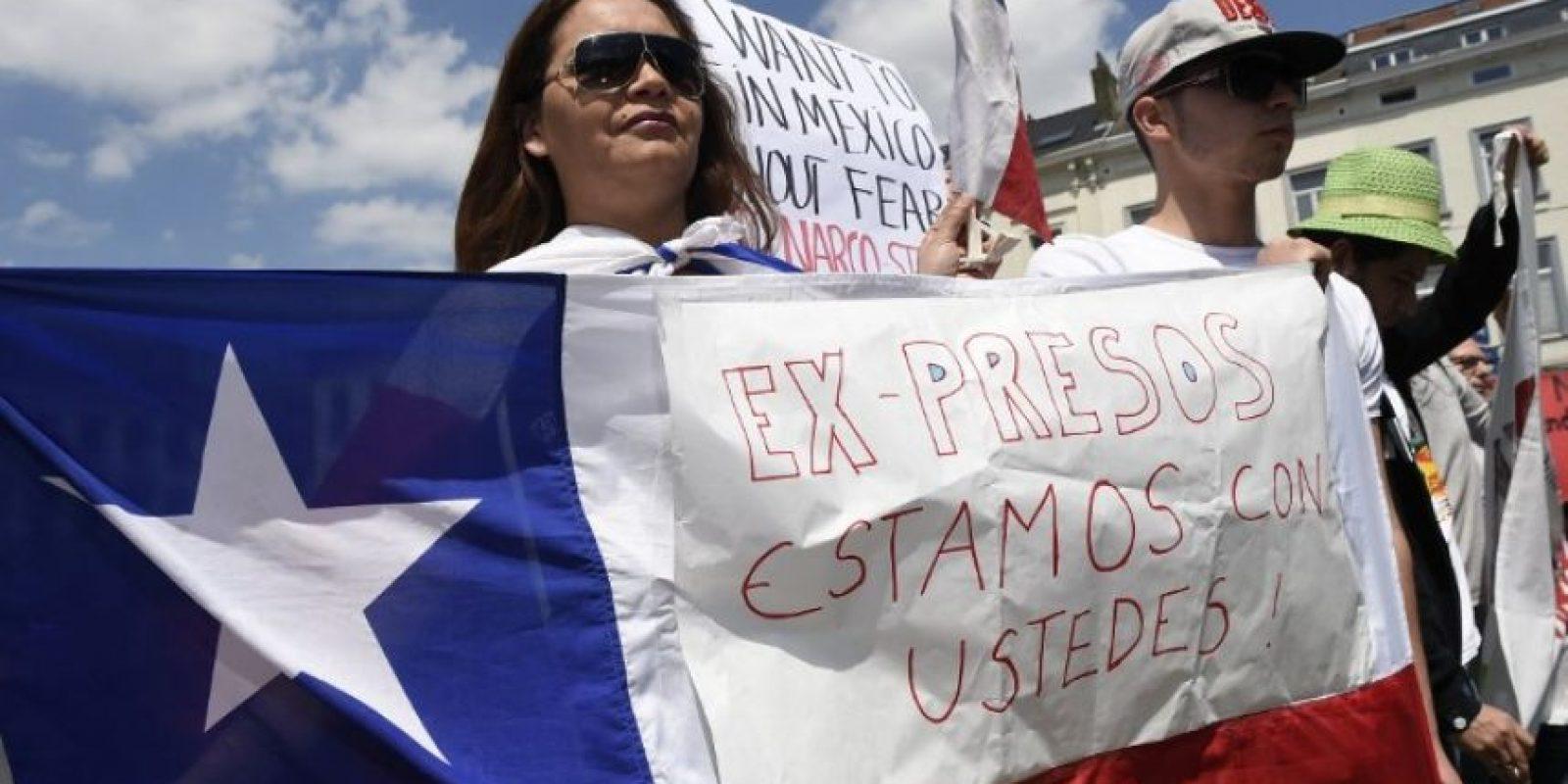 Y en contra de la presidenta Michelle Bachelet Foto:AFP