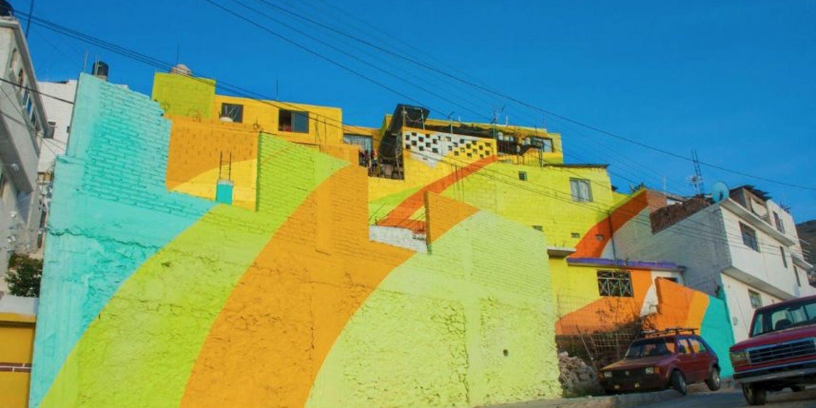 Se pintaron 20 mil metros cuadrados de fachadas de 209 casa. Foto:Vía facebook.com/muralismogermen