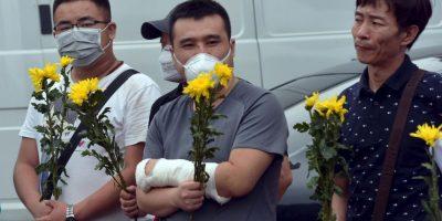 Vigilia por los muertos tras explosión en China. Foto:AFP