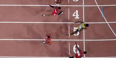 El jamaiquino ganó las medallas de oro en 100 metros, 200 metros y relevos 4×100 metros. Foto:Getty Images