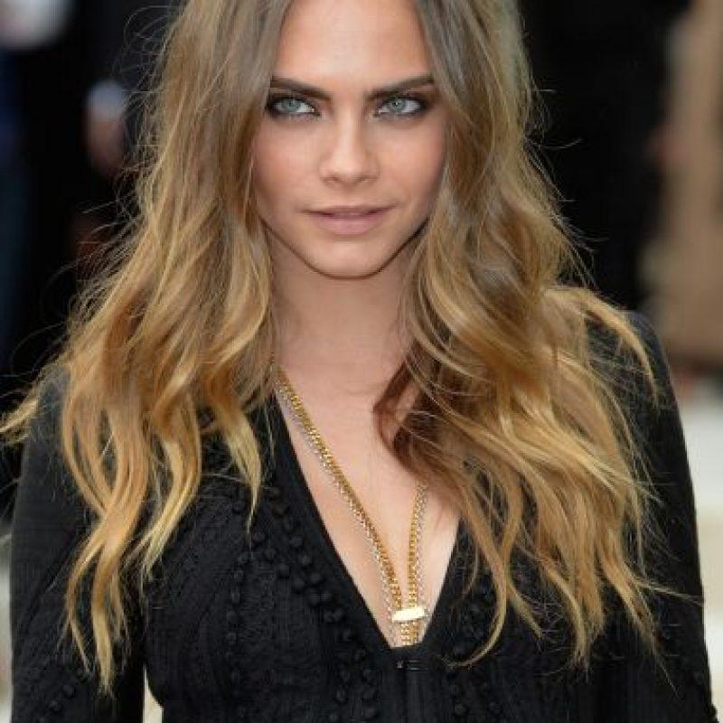 Con la modelo Cara Delevingne Foto:Getty Images