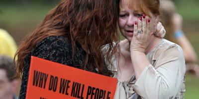 Sus huimos tenían 5 y 7 años cuando su padre fue asesinado Foto:AP