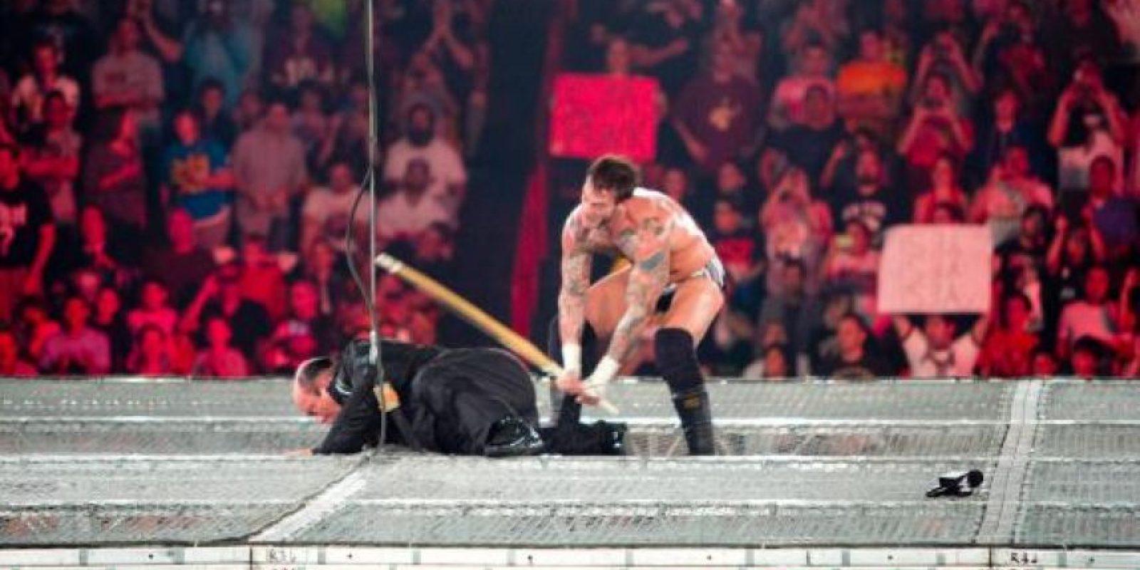 Paul Heyman y CM Punk Foto:WWE