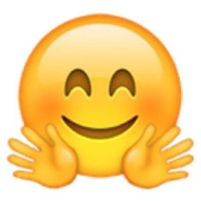 Rostro sonrojado con dos manos. Foto:vía emojipedia.org