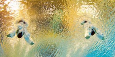 Las medallistas de plata Jennifer Abel y Pamela durante su participación de nado sincronizado en los Juegos Panamericanos 2015. Foto:AFP