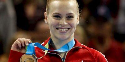 La canadiense ganó cinco medallas en gimnasia artística: all around, piso, viga de equilibrio, equipo y salto de caballo Foto:Getty Images