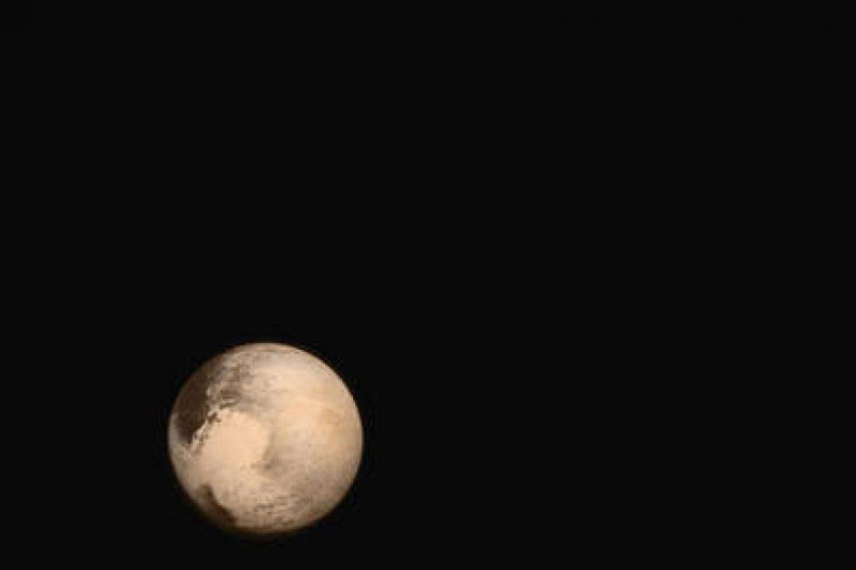 Plutón y su luna Charon en su color natural Foto:NASA.gov