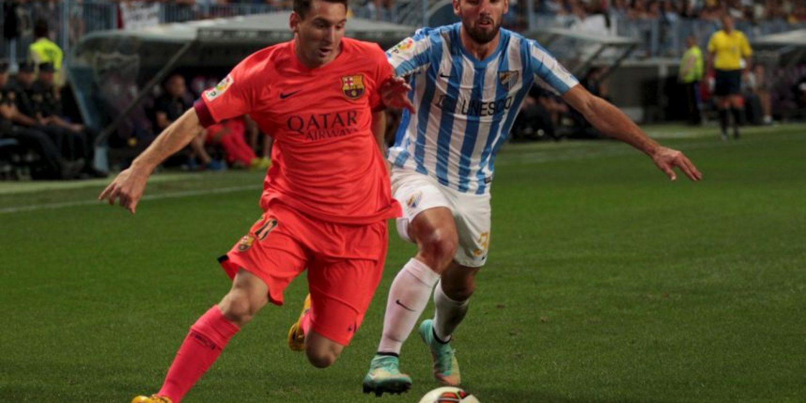 En septiembre de 2014, el argentino volvió a ignorar a un niño que invadió la cancha para saludarlo, al final del Málaga vs. Barcelona. Foto:Getty Images