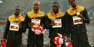 Nickel Ashmeade, Asafa Powell, Nesta Carter y Usain Bolt conquistaron los 4X100 metros, que curbieron en 37 segundos y 36 centésimas de segundo Foto:Getty Images